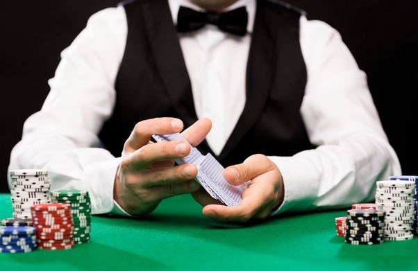 What's the role of the dealer in apoker game?